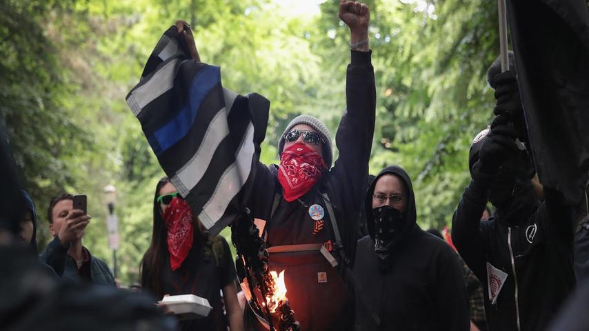 Thin Blue Line Racist Desecration Flag?
